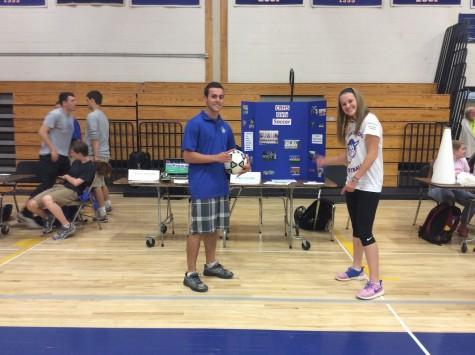 Alec Bogen and Larissa Cade represent soccer.