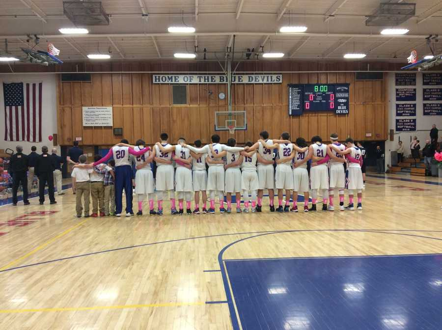 Devils Honor Alumnus, Defeat Huskies in OT at Annual Pink Out