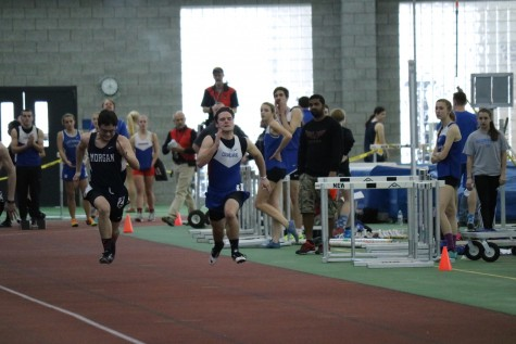 Westly Benjunas representing Coginchaug at an indoor track meet.