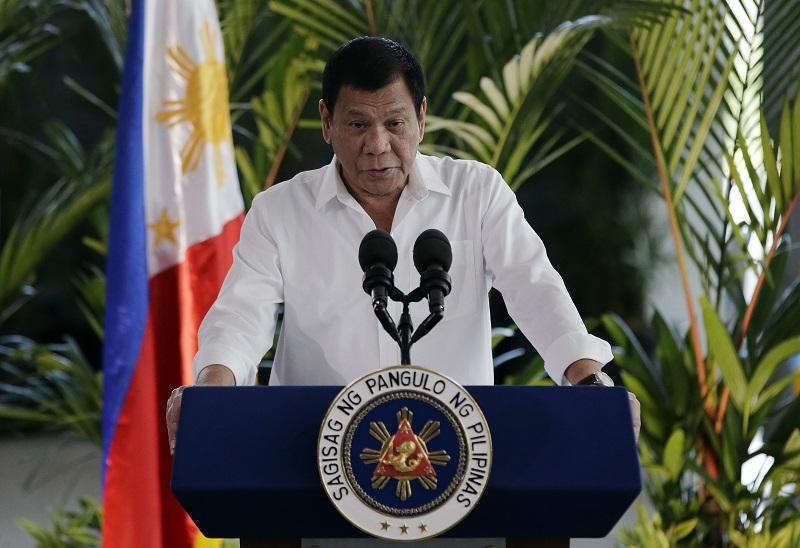 Philippine President Rodrigo Duterte delivers his speech during departure ceremonies at Manila's International Airport, Philippines on Wednesday, Nov. 9, 2016. Duterte is set to fly to Bangkok to pay his respects to Thailand's King Bhumibol Adulyadej. (AP Photo/Aaron Favila)