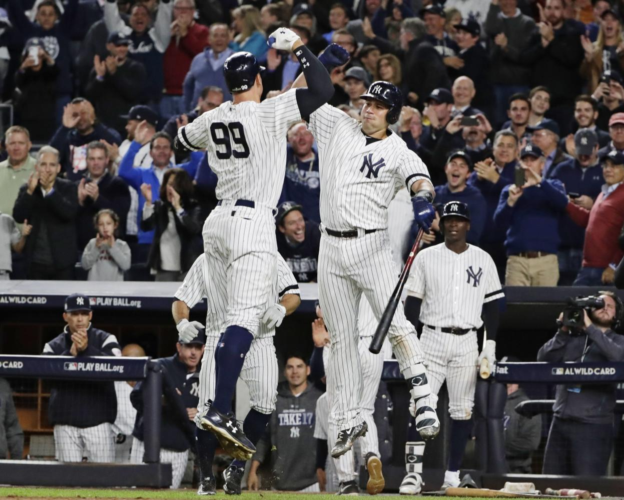 Aaron Judge (l.) celebrates with Gary Sanchez after hitting a two-run home run. (FRANK FRANKLIN II/AP)  *NY Daily News