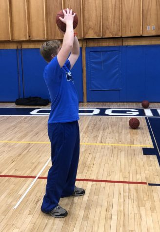CRHS Unified student Zach Ryer shoots around during his Unified Sports class.