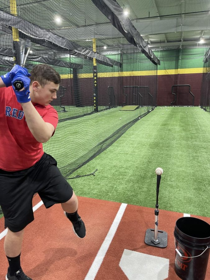 CRHS baseball player hitting off a tee at D-BAT in Cheshire.